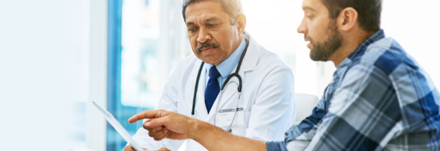 A doctor and patient discuss medical records
