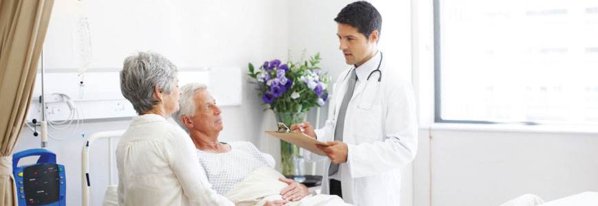 Physician speaking with ill patient and family member