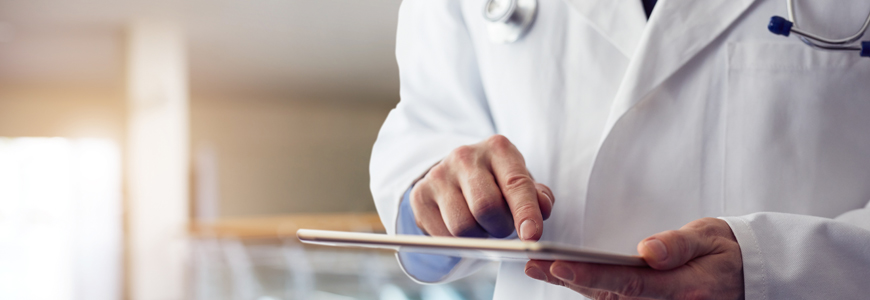 Doctor reading electronic medical record