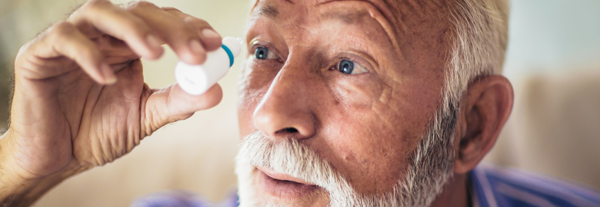 Patient administers eyedrops to himself